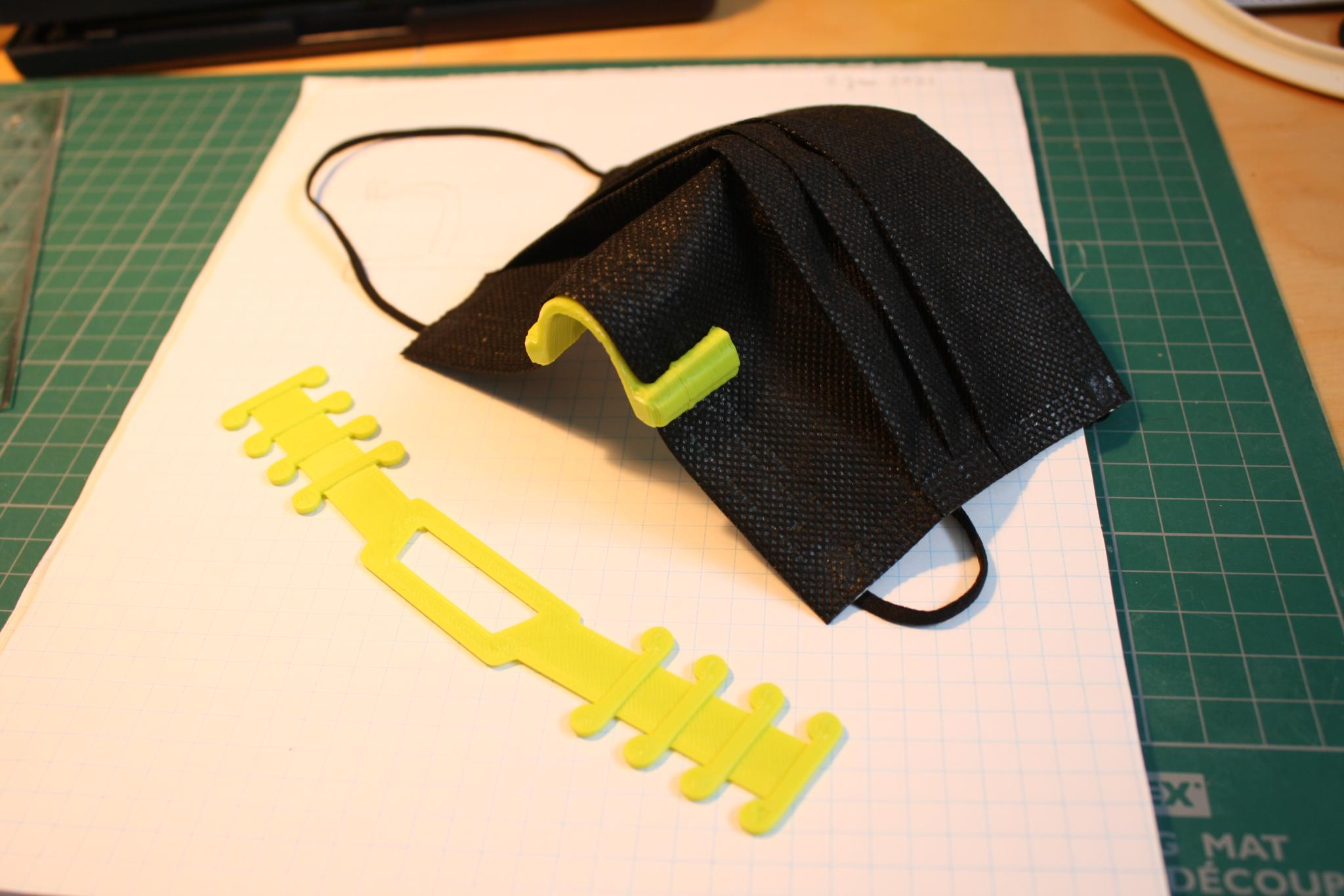 Surgical mask strap and nose clip